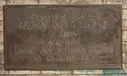 Sign about Brian Merriman on wall of Feakle graveyard